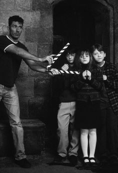 """Daniel Radcliffe, Emma Watson, and Rupert Grint as """"Harry Potter"""", """"Hermione Granger"""", and """"Ronald Weasley"""" on the set of """"Harry Potter and the Sorcerer's Stone"""", 2001"""