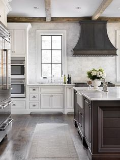 white & chocolate brown kitchen | rustic beams | zinc French hood