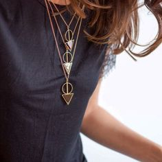 Layered necklaces and a simple top. So cute.