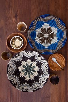 Blue/Grey Hope Basket: Craftswomen in Rwanda use time-old tradition to weave carefully dyed sisal fibers and sweet grass into stunning one-of-a-kind pieces rich in cultural meaning and purpose -- a perfect center piece, bread/fruit bowl, or wall hanging.  Baskets carry a special symbolism in Rwanda: friends give them to one another to celebrate milestones (weddings, births, etc.), and they are proudly displayed as a reflection of abundance in friendships, family and life.
