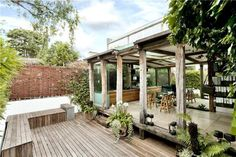 photo of designer conservatory garden with sliding folding doors and decking patio verandah