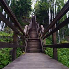 10 Day Minnesotans climbing the stairs from Lake Superior to the Split Rock Lighthouse in Two Harbors, MN. Click to see more from world-renowned travelers as they road-trip through Minnesota. #OnlyinMN