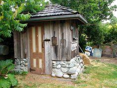 repurposed door ~ tools hanging ~stone base ~ hip roof