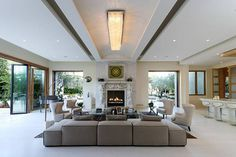 A Family Room in the Crescent Palace, the Yolanda Foster mansion which sold for millions was done by her.  Her decorating skills are amazing.  The impeccably decorated family room is complete with bar lounge & scenic views.
