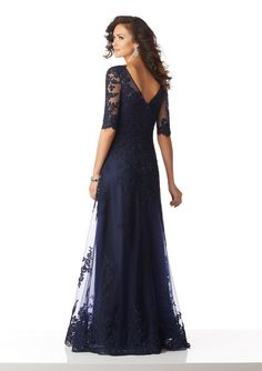 Shop Morilee's Mother of the Bride Gown Featuring Beaded Lace Appliqués on Net. Mother of the Bride Special Occasion Gown Featuring an Elegant Illusion Neckline and Beaded Lace Appliqués Throughout Mob Dresses, Bridesmaid Dresses, Wedding Dresses, Bridesmaids, Mother Of The Bride Dresses Long, Grooms Mother Dresses, Blue Evening Dresses, Evening Gowns, Bride Gowns