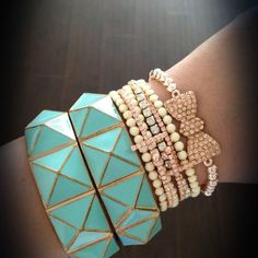 Turquoise pyramid bangles, cross bracelets, and rose gold beaded crystal bow!