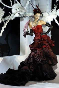 this is so over the top in design (most likely couture) but in a strange way...I like it!
