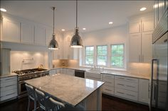 Natural light fills this kitchen. Follow the link for a full PH48 home photo gallery.