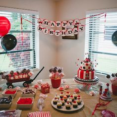 This was my boys 1st birthday party cake table. Radio Flyer Fire Truck