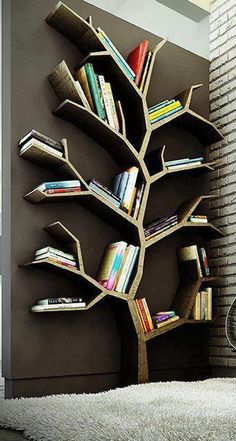 Beautiful Tree branches bookshelves case design. On a smaller scale with a bright wall as contrast for a kid's room maybe?