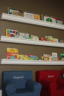 Rain Gutter Book Shelves  We have these in the playroom. :)