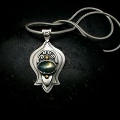 One of a kind Moonstone Pendant in Sterling Silver. Made with love!!  www.melissacaron.com