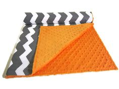 Just listed! What a fun blanket for a little boy! Grey and White Chevron with Orange Minky Dot by LilBitsofSugar, $36.00
