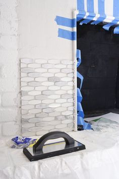good step by step how to tile over brick fireplace