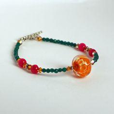 Orange Leopard Bubbles Bracelet, very pretty color contrasts. Handmade murano glass beads by Felice Designs. Charleston, SC. www.felicedesigns.com
