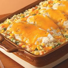 Cheesy Chicken and Rice Casserole ~ Always a favorite, Cheesy Chicken and Rice Casserole is a meal that can be easily customized from Mexican to Italian, just by switching the cheese!