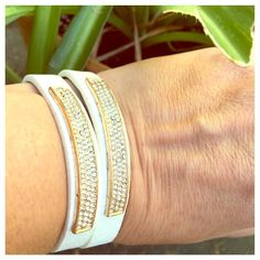 """LAYERED PAVE BRACELET! T&J DESIGNS BRACELET! White vegan leather pave bracelet with adjustable straps. Fits up to an 8"""" wrist. Layer them with other bracelets, add earrings, a watch from my closet, and get an on trend, fresh spring look. Gold trim with rhinestones, too cute! Price is for EACH, five available. Bundle and SAVE! ✅Price firm unless bundled.✅ T&J Designs Jewelry Bracelets"""