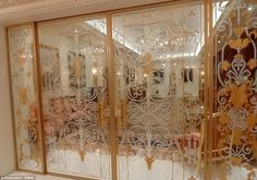 Precious: This pair of glass partition sliding doors have a dore bronze metal frame struct...