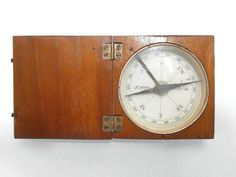 "SOLD $15.00.  A nice little working compass, but we don't know if it is accurate. It measures approximately 2 3/4"" by 2 3/4"" by 1"" when closed and has two brass hook closures and hinges... Click on the image above for more info or to buy from WileWood. Thanks for your interest!"