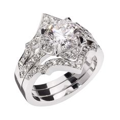Stephen Webster Two in One engagement ring set in 18ct Fairtrade white gold with a 2ct Forevermark diamond and pave diamonds