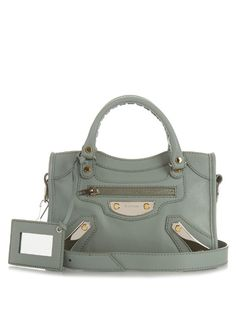 Add a fresh tone to your accessories portfolio with Balenciaga's duck-egg green Classic Mini City bag. The smooth calf-leather construction features the label's signature palladium metal, and metallic edge hardware. Hold it by the braided top handles, or wear across the body using the shoulder strap. | Available at MATCHESFASHION.COM