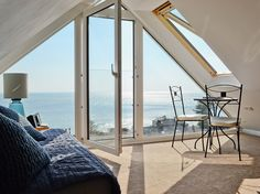 The Loft (ref in Downderry, Cornwall This compact and contemporary studio loft has a wonderful large glass apex window with a Juliet balcony looking directly out to sea. The Loft, Loft Room, Bedroom Loft, Attic Conversion Balcony, Style At Home, Gable Window, Apex Roof, Bedroom Balcony, Balcony Window