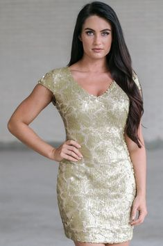 0baffec428c This stunning embellished cap sleeve party dress is one of our absolute  favorites! We love. Lily Boutique