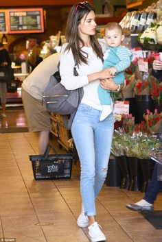 Relaxed style: Alessandra Ambrosio dressed down in jeans and trainers as she visited Whole Foods in Santa Monica