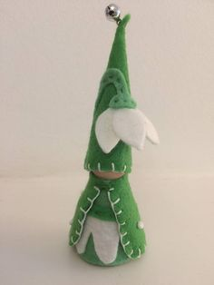 A Waldorf inspired Spring Snowdrop Gnome. Perfect for small world play or as a seasonal decorative piece. Snowdrop Gnome is handcrafted from wooden doll pegs, felt and cotton thread. The hat is secured with glue. It features a tiny tinkly bell on the top and small snow beads on