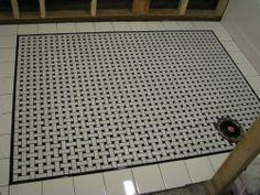 for shower pan - small basketweave tile with subway (rather than 4x4) border and dark gray grout - do rest of floor in the giant version!