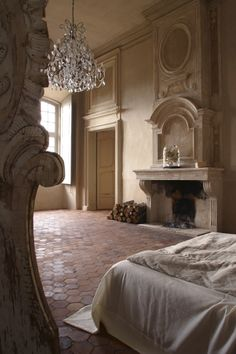 Sleeping quarters in the Château de Moissac (via Desire to Inspire) #bedroom #chandelier #fireplace #Provence