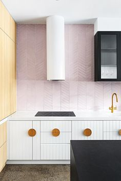 <b>Sweet statement</b> Create a soft, feminine look with a whole wall in pale pink tiles. Extending the splashback to fill the entire wall creates a focal point that transforms the overall look and feel of the space. <i>Design