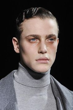 Wet look finger waves and turtle neck =
