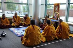 A group of Buddhist monks chant mantra prayers before beginning work on an intricate sand exhibit in the Student Center at the westside campus of Western Connecticut State University in Danbury Monday, Oct. 15, 2012. Photo: Carol Kaliff / The News-Times