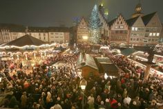 Visitors walk through the Christmas market at Roemerberg square on its opening day in Frankfurt, Germany (2013).