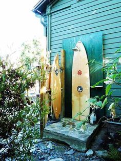 Awesome outdoor shower from a surfboard. Perfect for the boat storage/wet gear hanging area.
