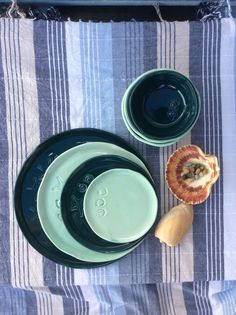 Handmade ceramic dinnerware. Mix& Match plates of different size: 33cm, 27cm, 22cm and 16cm. Colours: Deep Sea and Blue Ice