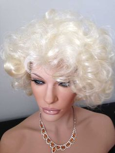 Curly 60's Bouffant Showgirl Wig, reminiscent of Marily Monroe. Color: Pale Blonde.