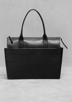 & Other Stories | Pleat Handbag in black | 100% cow leather, Lining: 100% polyester | Snap-button closure, side pocket.  Two compartment bag.  Zipped pocket with a leather zip puller, phone pocket, and D ring for keys. | Dimensions: 37 x 28 x 9 cm | £145