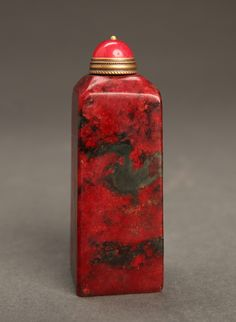 "chinese-carved-soapstone-snuff-bottle Tower form in red and dark gray mottle. 2.875"" H x 1"" W. Excellent condition."