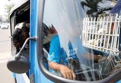 Idul Adha goat delivery by Bajaj three-wheeled auto rickshaw in Jakarta on…