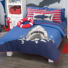 Blue Comforter with sharks, perfect for kids who love sharks. Fabric 50% polyester / 50% Cotton stuffed 100% polyester Includes: Twin: 1 Comforter 64,93 inch x 90,55 inch 1 Pillow Sham 25,98 inch x 18