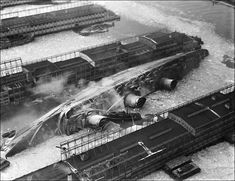 """During World War II, SS Normandie was seized by US authorities at New York and renamed USS Lafayette. In 1942, the liner caught fire while being converted to a troopship, capsized onto her port side and came to rest on the mud of the Hudson River. Although salvaged at great expense, restoration was deemed too costly and she was scrapped in October 1946."""