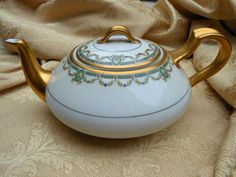 Haviland Limoges of France Teapot with green and gold garland I mark. $45.99, via Etsy.