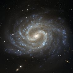The Lost Galaxy. This image depicts the galaxy NGC 4535, in the constellation of Virgo (The Maiden), on a beautiful background full of many distant faint galaxies. Its almost circular appearance shows that we observe it nearly face-on. In the centre of the galaxy, there is a well-defined bar structure, with dust lanes that curve sharply before the spiral arms break from the ends of the bar. The bluish colour of the spiral arms points to the presence of a large number of hot young stars.