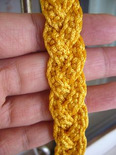 Crochet purse strap - I think this is just three rows of hdc #braided, but you could always put an extra edging (in a contrasting or complementary color!) on after you braid it...