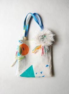 Screenprinted bag with pompom/tassle