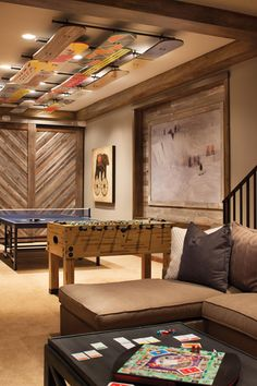 Faux snowboards adorn the ceiling of the #play #room. Interior Design by Kristin Peake.