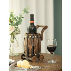 """Size: 5.25"""" W x 7.5"""" D x 10"""" H Vintage barrel cart wine holder makes it a great gift for wine connoisseurs Holds securely 1 bottle of wine Durable wood composition Use as a centerpiece decoration Complete the decor of your room with this vintage barrel… Centerpiece Decorations, Bottle Holders, Wine Rack, Wood Crafts, Barrel, Great Gifts, Projects To Try, Shapes, Vintage"""