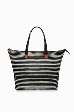 Our popular black and cream stripe now comes in our everyday Daytripper tote! Whether using as a stylish commuter bag or a cute travel carryall, the Daytripper has you covered.